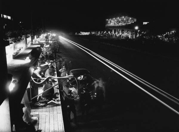 Le Mans, France. 24th - 25th June 1950 Miles Collier/Sam Collier (Cadillac Coupe de Ville), 10th position, in the pits during the night, action. World Copyright: LAT Photographic Ref: Autocar Glass Plate C27268.