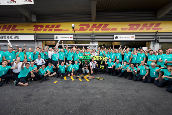 Spa-Francorchamps, Spa, Belgium. Sunday 23 August 2015. Lewis Hamilton, Mercedes AMG celebrates with Paddy Lowe, Executive Director (Technical), Mercedes AMG and the rest of the team after the race. World Copyright: Steve Etherington/LAT Photographic ref: Digital Image SNE22747