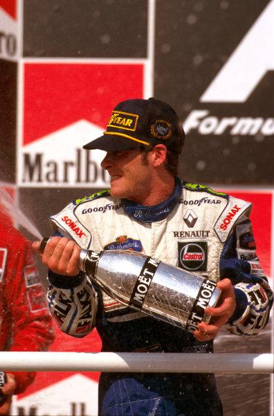 Buenos Aires, Argentina.11-13 APRIL 1997.Jacques Villeneuve (Williams FW19 Renault) celebrates 1st position on the podium.Ref-97 ARG 08.World Copyright - LAT Photographic