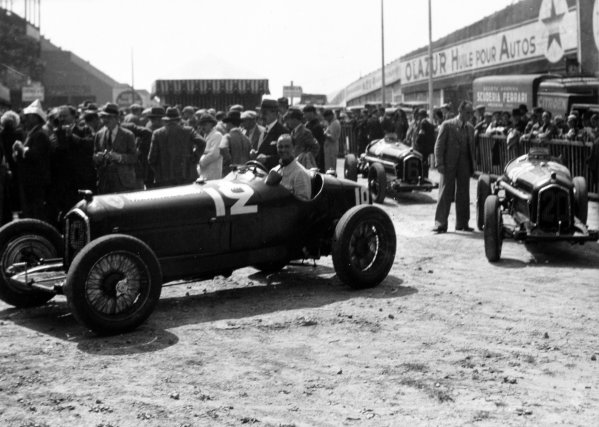 """1934 French Grand Prix Montlhery, France. 1 July 1934 The Alfa Romeo Tipo-B """"P3"""" cars of Louis Chiron (in car), Carlo Felice Trossi and Achille Varzi arrive for scrutineering, atmosphere World Copyright: Robert Fellowes/LAT PhotographicRef: 34FRA04"""