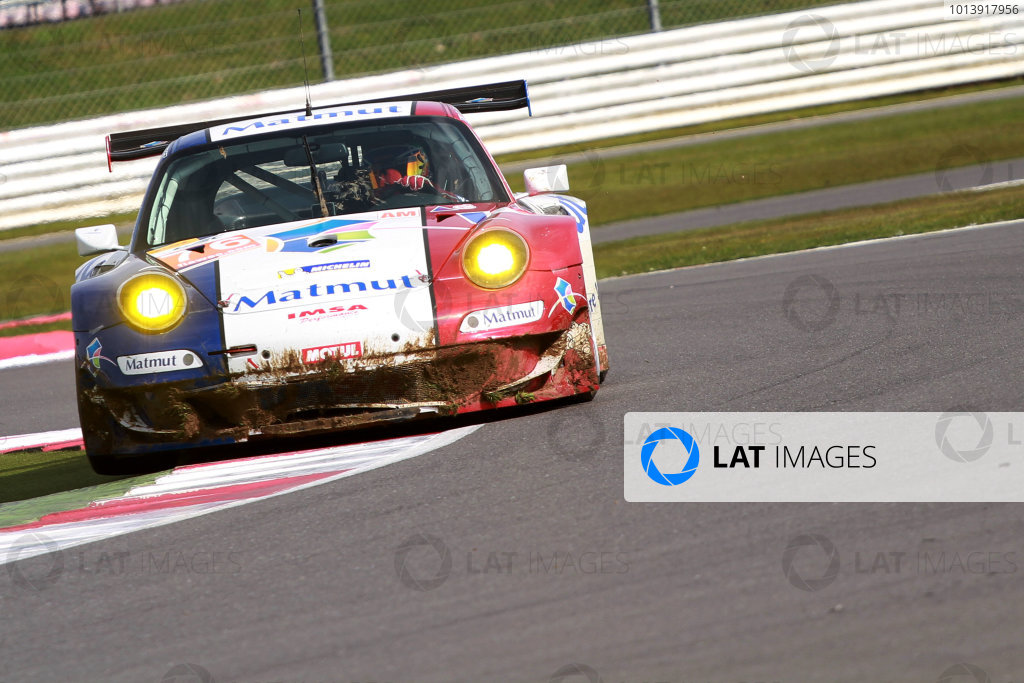 2013 FIA WEC Championship, Silverstone, Northamptonshire. 12th - 14th April 2013. Raymond Narac / Christophe Bourret / Jean Karl Vernay IMSA Performance Matmut Porsche 911 GT3 RSR World Copyright: Ebrey / LAT Photographic.