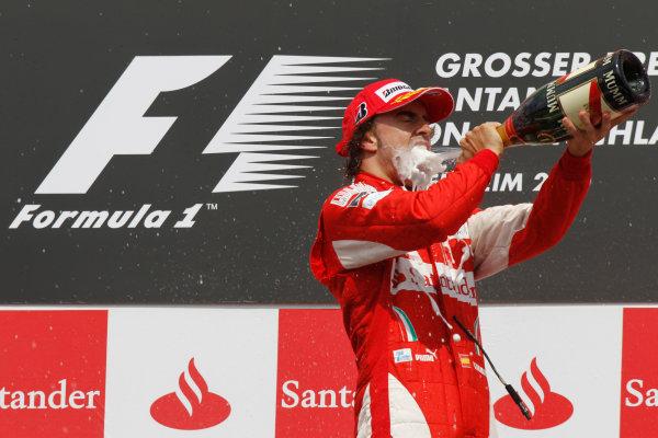 Hockenheimring, Hockenheim, Germany 25th July 2010 Fernando Alonso, Ferrari F10, 1st position, sprays the champagne on the podium. Portrait. Podium.  World Copyright: Andrew Ferraro/LAT Photographic ref: Digital Image _Q0C4571