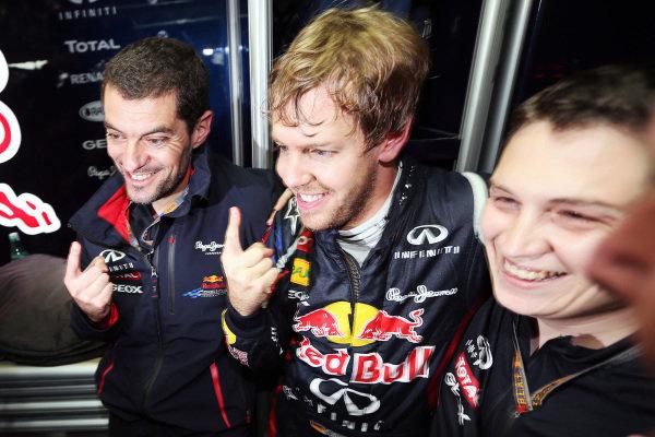 World Champion Sebastian Vettel (GER) Red Bull Racing celebrates with Guillaume Rocquelin (FRA) Red Bull Racing Race Engineer and Tim Malyon (GBR) Red Bull Racing Performance Engineer. Formula One World Championship, Rd20 Brazilian Grand Prix, Race, Sao Paulo, Brazil, 25 November 2012.  BEST IMAGE