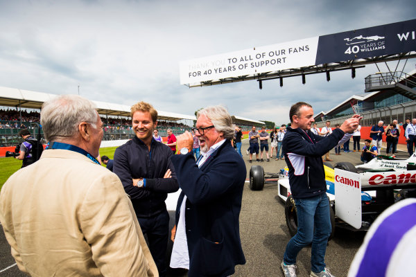 Williams 40 Event Silverstone, Northants, UK Friday 2 June 2017. Patrick Head talks to Nico and Keke Rosberg on the Silverstone grid. World Copyright: Sam Bloxham/LAT Images ref: Digital Image _W6I6527
