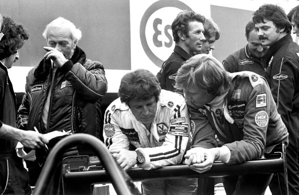 Zolder, Belgium. 21st May 1978. Mario Andretti and Ronnie Peterson talk in the pit lane with team boss Colin Chapman, portrait.  World Copyright: LAT Photographic. Ref: B/W Print.