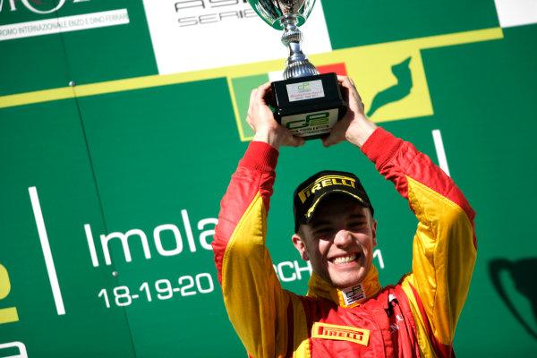 Imola, Italy. 20th March 2011. Sunday Race.Dani Clos, (ESP, Racing Engineering) celebrates victory on the podium. Portrait.    World Copyright: Drew Gibson/GP2 Media Service.ref: Digital Image _Y8P0558