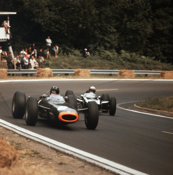 Rouen-les-Essarts, France.26-28 June 1964.Graham Hill (BRM P261) leads Phil Hill (Cooper T73 Climax). They finished in 2nd and 7th positions respectively.Ref-3/1289.World Copyright - LAT Photographic