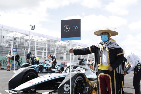 A grid model in traditional costume with the car of Nyck de Vries (NLD), Mercedes Benz EQ, EQ Silver Arrow 02