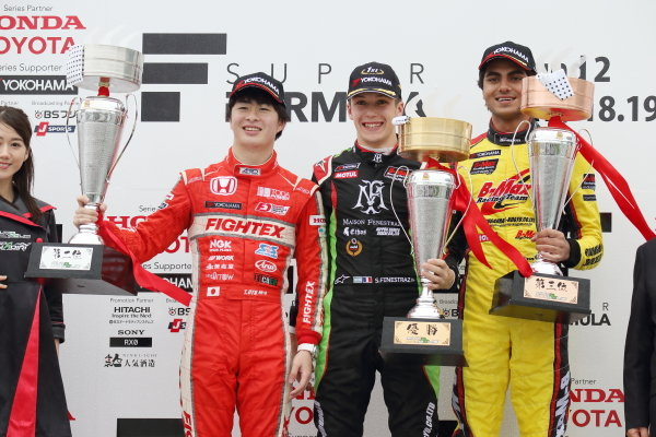 Race Winner Sacha Fenestraz, B-Max Racing with motopark F3, Toshiki Oyu, TODA FIGHTEX and Enaam Ahmed, B-Max Racing with motopark F3 celebrate on the podium with the trophy