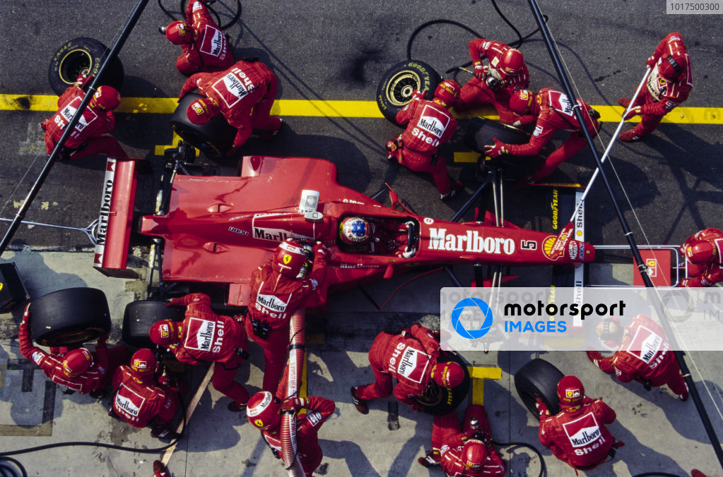 Michael Schumacher, Ferrari F310B, makes a pitstop.