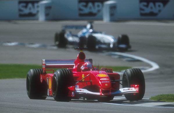 2001 United States Grand Prix.Indianapolis, Indiana, USA.28-30 September 2001.Michael Schumacher (Ferrari F2001) 2nd position, with Juan-Pablo Montoya (Williams FW23 BMW) behind.Ref-01 USA 14.World Copyright - LAT Photographic