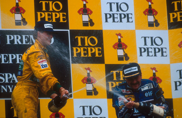 1992 Spanish Grand Prix.Catalunya, Barcelona, Spain.1-3 May 1992.Nigel Mansell (Williams Renault) 1st position and Michael Schumacher (Benetton Ford) 2nd position on the podium.Ref-92 ESP 02.World Copyright - LAT Photographic