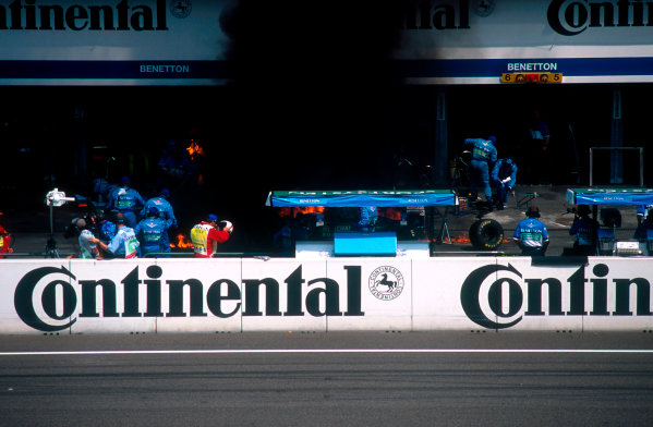 1994 German Grand Prix.Hockenheim, Germany.29-31 July 1994.Jos Verstappen (Benetton B194 Ford) came in for his pitstop. As the Refueller pulled the fuel hose away the valve stuck open allowing fuel to still come out of the nozzle and over the car which ignited into a huge fireball. The fire was delt with quite swiftly though.Ref-94 GER 44.World Copyright - LAT Photographic