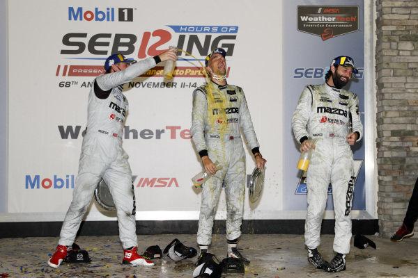 #55 Mazda Team Joest Mazda DPi, DPi: Jonathan Bomarito, Harry Tincknell, podium, champagne, orange juice