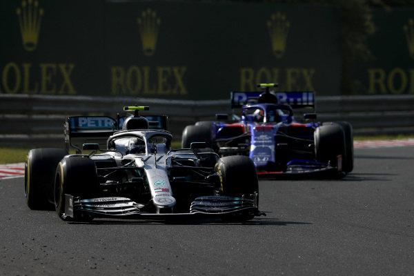 Valtteri Bottas, Mercedes AMG W10, leads Alexander Albon, Toro Rosso STR14
