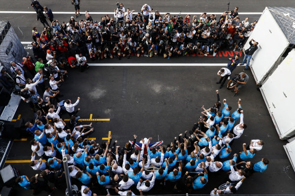 The Mercedes team gather around their driver Lewis Hamilton, Mercedes AMG F1, after securing a 5th world drivers championship title