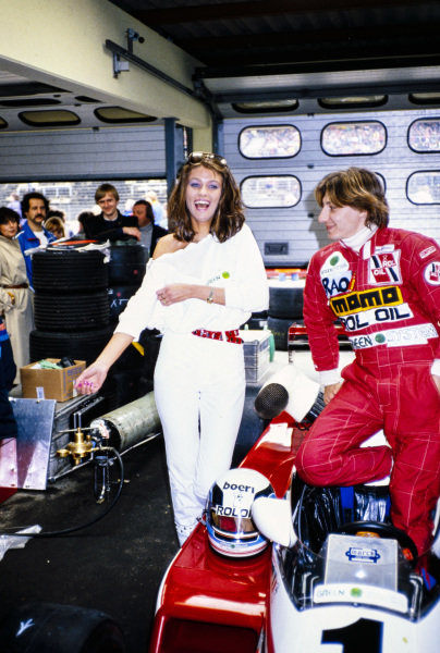 Beppe Gabbiani, March 832 BMW/Rosche, with a glamour model in the garage.