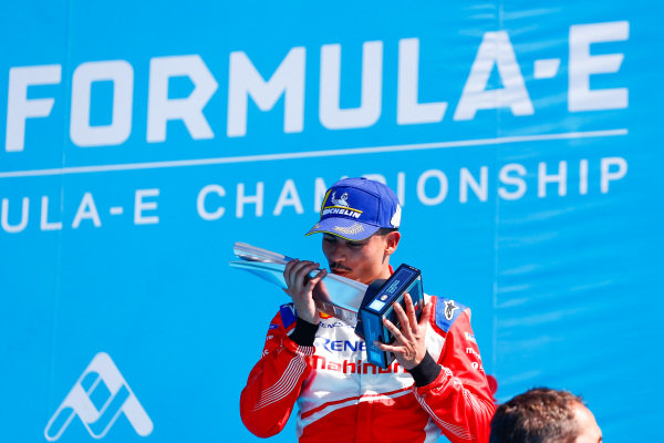 Pascal Wehrlein (DEU), Mahindra Racing, kisses his 2nd place trophy on the podium