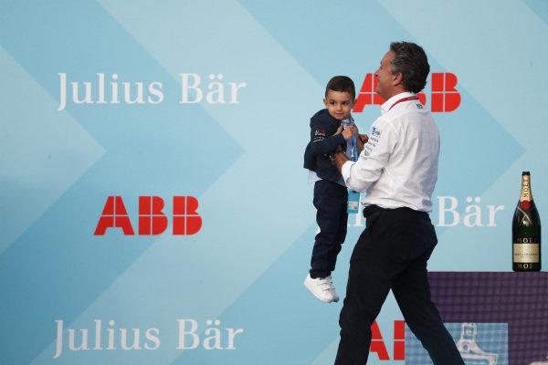 Alejandro Agag, CEO, Formula E, removes the son of Sébastien Buemi (CHE), Nissan e.Dams from the podium