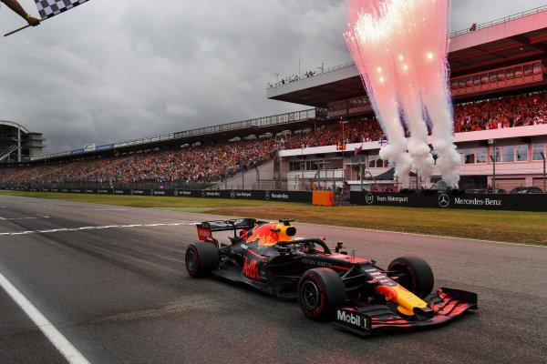 Race winner Max Verstappen, Red Bull Racing RB15 crosses the finish line