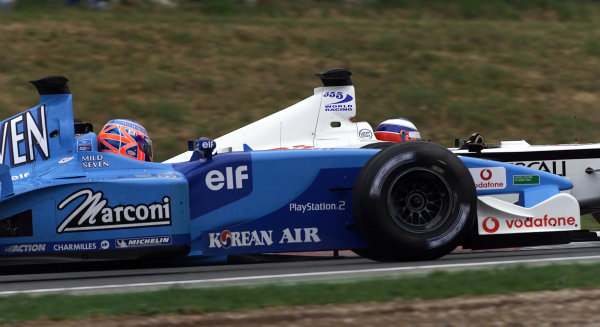 2001 Spanish Grand PrixCatalunya, Barcelona, Spain. 27-29 April 2001.Olivier Panis (B.A R. 003 Honda) passes Jenson Button (Benetton B201 Renault).World Copyright - Steve Etherington/LAT Photographicref: 18 mb Digital Image