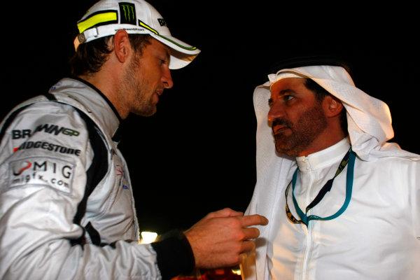 Yas Marina Circuit, Abu Dhabi, United Arab Emirates1st November 2009.Jenson Button, Brawn GP BGP001 Mercedes, 3rd position, with Mohammed Bin Sulayem. Portrait. VIPs.World Copyright: Charles Coates/LAT Photographic ref: Digital Image _26Y3174