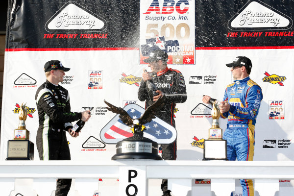 Verizon IndyCar Series ABC Supply 500 Pocono Raceway, Long Pond, PA USA Sunday 20 August 2017 Will Power, Team Penske Chevrolet, Josef Newgarden, Team Penske Chevrolet, Alexander Rossi, Curb Andretti Herta Autosport with Curb-Agajanian Honda celebrate with champagne on the podium World Copyright: Phillip Abbott LAT Images ref: Digital Image abbott_pocono_0817_8076