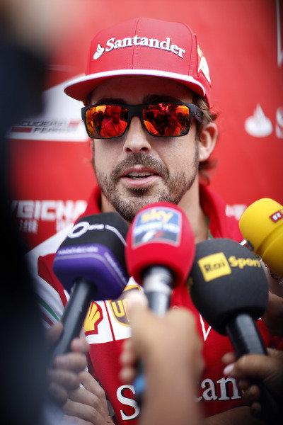 Marina Bay Circuit, Singapore. Thursday 18 September 2014. Fernando Alonso, Ferrari, talks to the press. World Copyright: Alastair Staley/LAT Photographic. ref: Digital Image _R6T6630