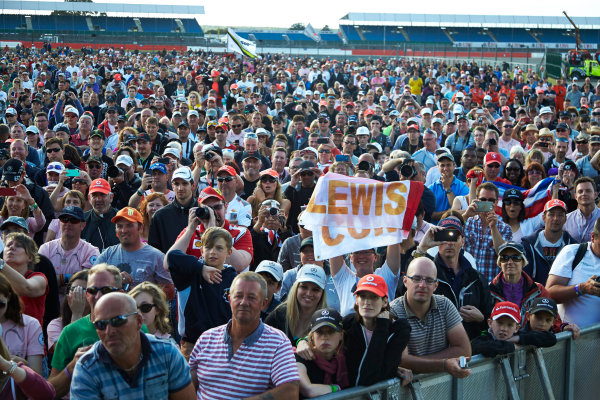 Silverstone, Northamptonshire, England. Sunday 6 July 2014. A huge crowd gathers to celebrate victory for Lewis Hamilton, Mercedes AMG, 1st Position. World Copyright: Steve Etherington/LAT Photographic. ref: Digital Image SNE20585