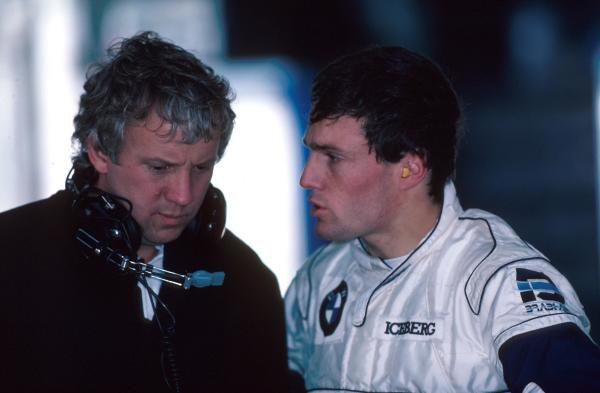 Andrea de Cesaris(ITA) and Charlie Whiting, left1987