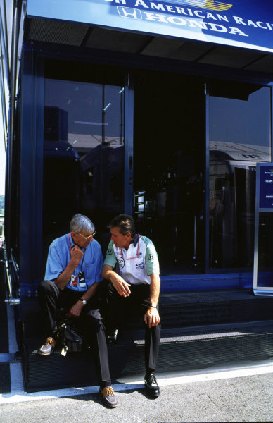 Hungaroring, Hungary.10-13 August 2000.B.A R. Managing Director Craig Pollock talks to Ken Tyrrell. Tyrrell was the team that British American Racing took over.Ref-2k Hungary A42World Copyright - LAT Photographic