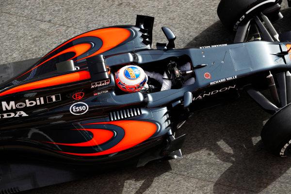 Circuit de Catalunya, Barcelona, Spain Monday 22 February 2016. Jenson Button, McLaren MP4-31 Honda, gets pushed back into the garage. World Copyright: Steven Tee/LAT Photographic ref: Digital Image _H7I0409
