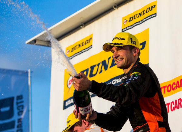2015 British Touring Car Championship, Silverstone, Northamptonshire, England. 26th - 27th September 2015. Colin Turkington (GBR) Team BMR Volkswagen Passat CC, 1st position, on the podium. World Copyright: Zak Mauger/LAT Photographic. ref: Digital Image _L0U4859