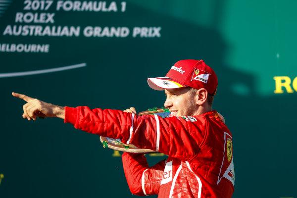 Albert Park, Melbourne, Australia. Sunday 26 March 2017. Sebastian Vettel, Ferrari, 1st Position, celebrates with his trophy. World Copyright: Glenn Dunbar/LAT Images ref: Digital Image _X4I4283