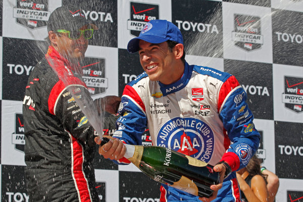 17-19 April, 2015, Long Beach, California USA Helio Castroneves and Juan Pablo Montoya celebrate with champagne ?2015, Ernie Masche LAT Photo USA
