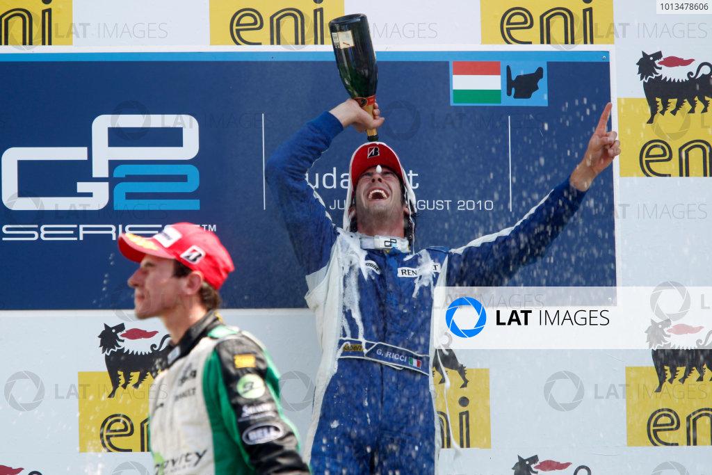 Hungaroring, Budapest, Hungary. 1st August.Sunday Race.Giacomo Ricci (ITA, DPR) celebrates his victory on the podium with Christian Vietoris (GER, Racing Engineering).Photo: Andrew Ferraro/GP2 Media Service.Ref: __Q0C7983 jpg