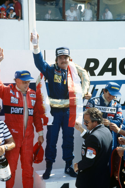 Dijon-Prenois, France. 29 August 1982. Keke Rosberg, Williams FW08-Ford, 1st position, Alain Prost, Renault RE30B, 2nd position, and Niki Lauda, McLaren MP4/1B-Ford, 3rd position, podium. Ref: 82 SWI 10. World Copyright: LAT Photographic