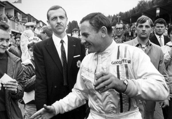 1968 Belgian Grand Prix. Spa-Francorchamps, Belgium. 9th June 1968. Bruce McLaren (McLaren M7A-Ford), 1st position, celebrates, portrait. World Copyright: LAT Photographic. Ref: B/W Print.