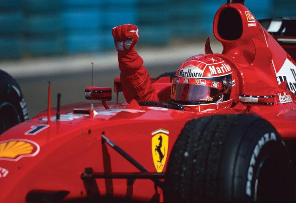 Hungaroring, Hungary. 17th - 19th August 2001.Race winner Michael Schumacher, Ferrari F2001 clinches his 4th World driver championship, and Ferrari's 3rd consecutive constructors title.World CopyrighT: Clive Rose/ LAT PhotographicRef: 01 HUN 20.