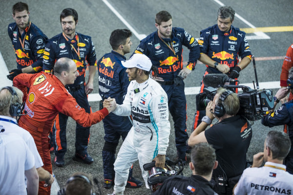 Lewis Hamilton, Mercedes AMG F1, 1st position, shakes hands with Red Bull and Ferrari mechanics at the end of the race