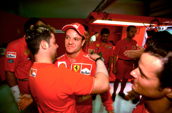 2001 Malaysian Grand Prix.Sepang, Kuala Lumpur, Malaysia. 16-18 March 2001.Rubens Barrichello (Ferrari) is congratulated by his team mechanics after taking 2nd position.World Copyright - Charles Coates/LAT Photographic ref:35mm Image A39