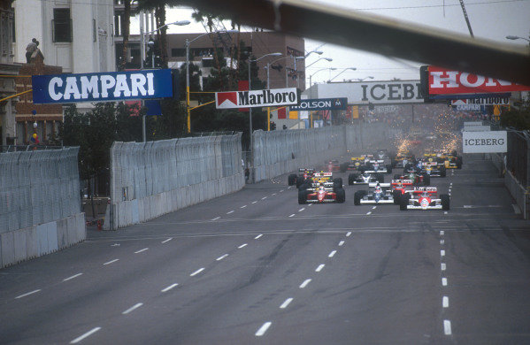 1990 United States Grand Prix.Phoenix, Arizona, USA.9-11 March 1990.Gerhard Berger (Mclaren MP4/5B Honda) leads Jean Alesi (Tyrrell 018 Ford), Andrea de Cesaris (Dallara 190 Ford), Ayrton Senna (Mclaren MP4/5B Honda) and Pierluigi Martini (Minardi M189 Ford) at the start, as the rest of the field sends up a shower of sparks behind.Ref-90 USA 02.World Copyright - LAT Photographic