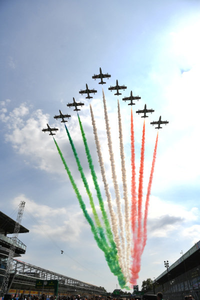 An Italian air display leaves a smoke trail of the Tricolore over the grid