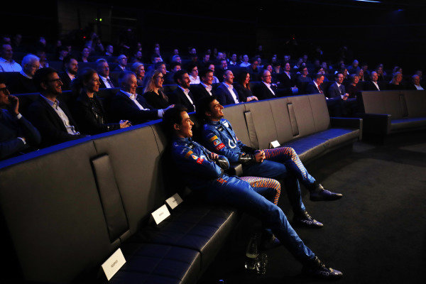 Carlos Sainz Jr, McLaren, and Lando Norris, McLaren watch the launch of the McLaren MCL35