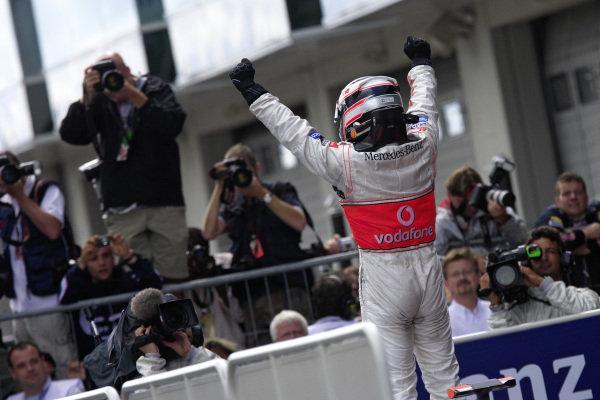 Fernando Alonso celebrates victory in parc fermé.