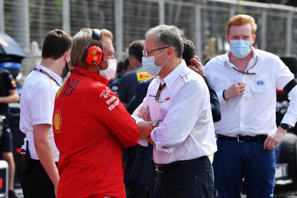 Stefano Domenicali, CEO, Formula 1, talks to a Ferrari employee