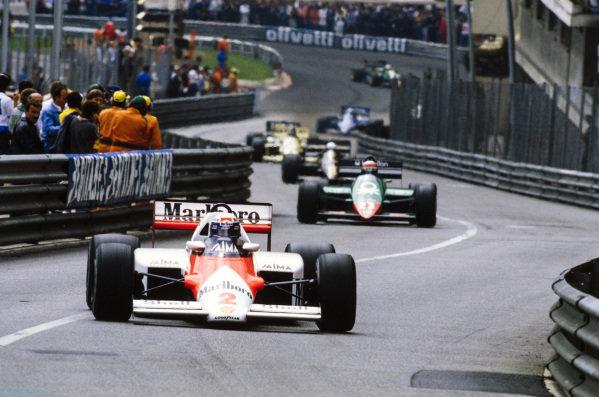 Alain Prost, McLaren MP4-2B TAG, leads Eddie Cheever, Alfa Romeo 185T, and Elio de Angelis, Lotus 97T Renault.