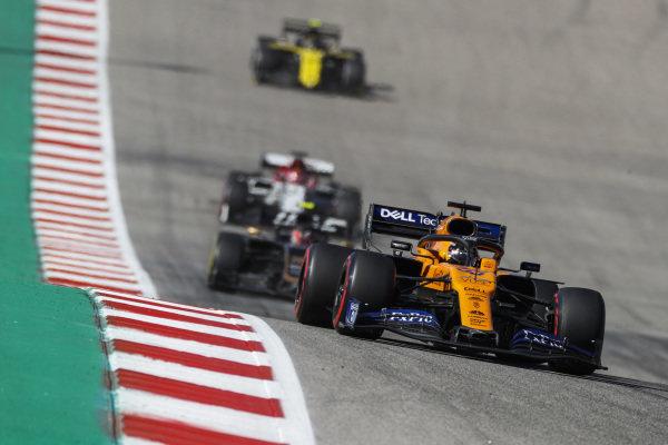 Carlos Sainz Jr., McLaren MCL34, leads Kevin Magnussen, Haas VF-19, Kimi Raikkonen, Alfa Romeo Racing C38, and Nico Hulkenberg, Renault R.S. 19