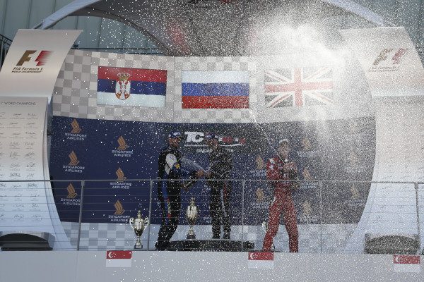 (L to R): Second placed Dusan Borkovic (SRB) B3 Racing Team, race winner Mikhail Grachev (RUS) WestCoast Racing and third placed at James Nash (GBR) Team Craft-Bamboo celebrate on the podium with the champagne at TCR International Series, Rd9, Marina Bay Street Circuit, Singapore, 16-18 September 2016.