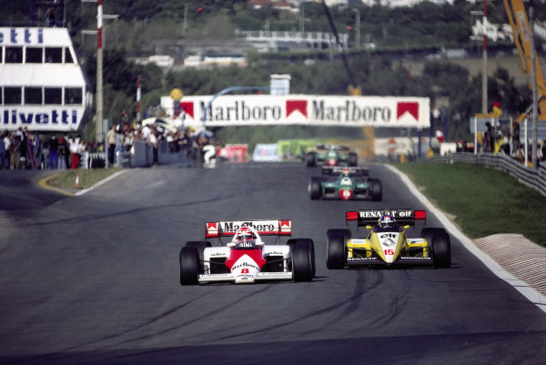 Niki Lauda, McLaren MP4-2 TAG, leads Patrick Tambay, Renault RE50.